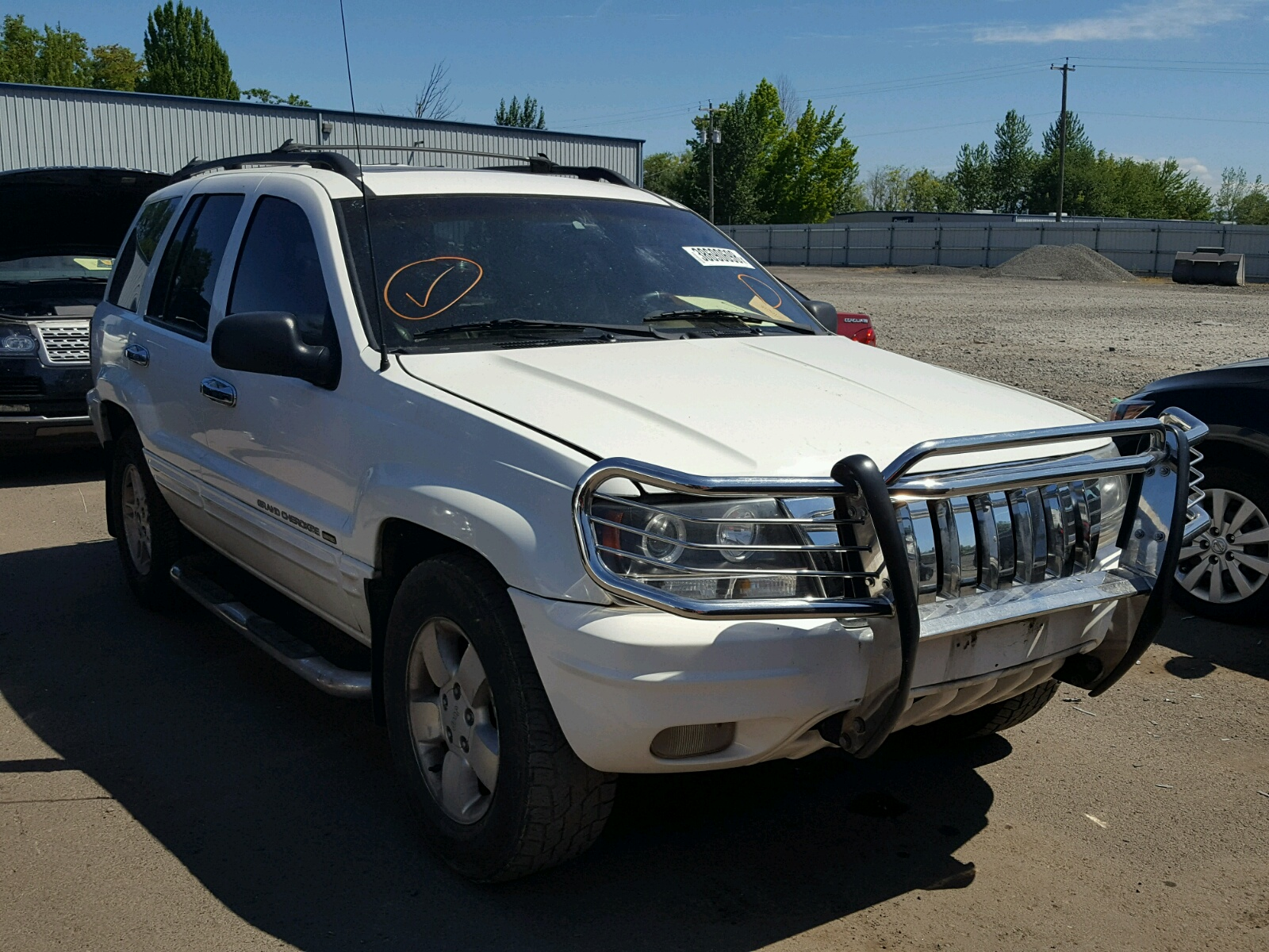Salvage 2001 Jeep GRAND CHEROKEE for sale