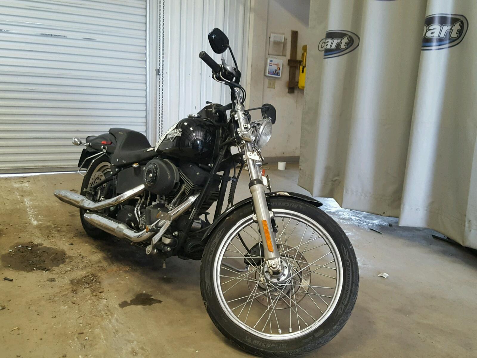 Salvage 2004 Harley-Davidson FXSTB for sale