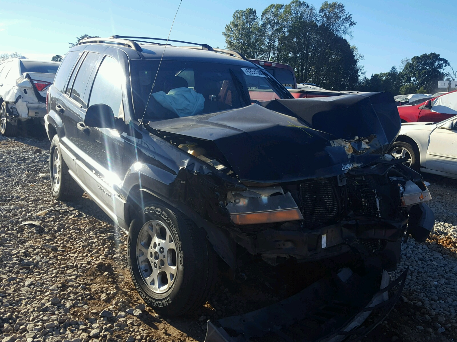 Salvage 2000 Jeep GRAND CHEROKEE for sale