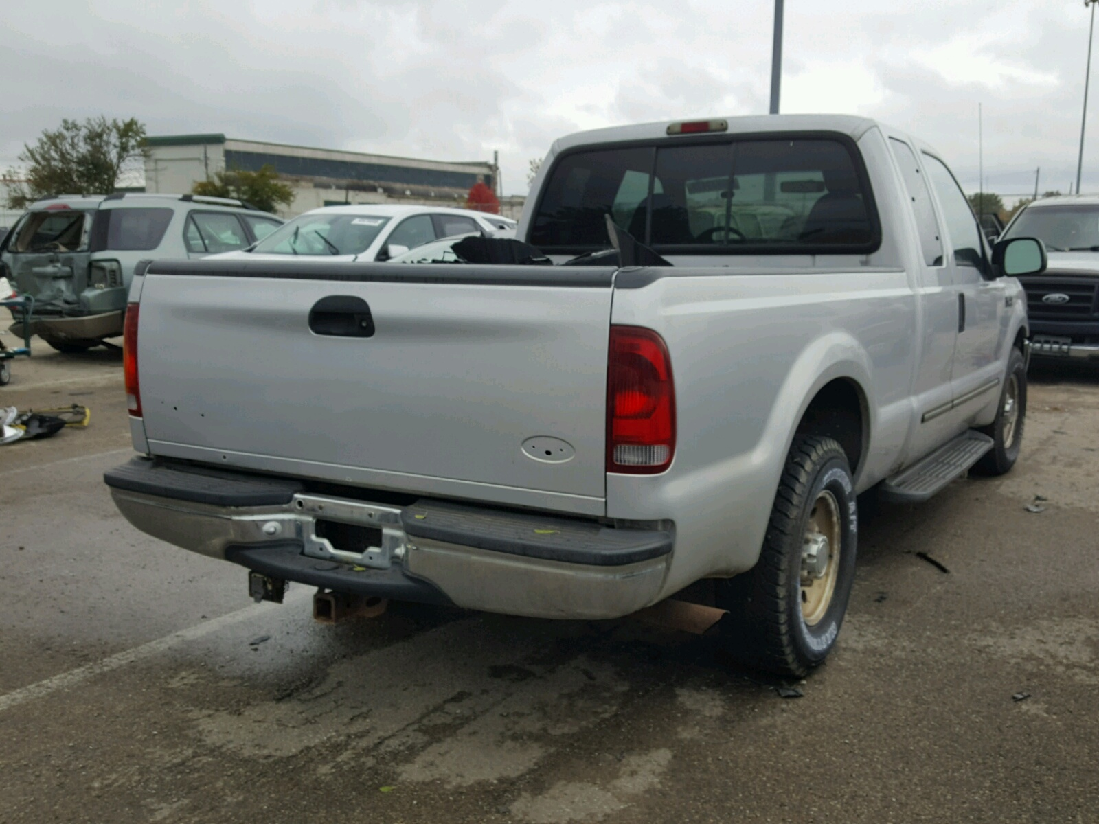 Auto Auction Ended On Vin 1ftnx20s1yeb23237 2000 Ford F250 Super In Duty 68l Rear View
