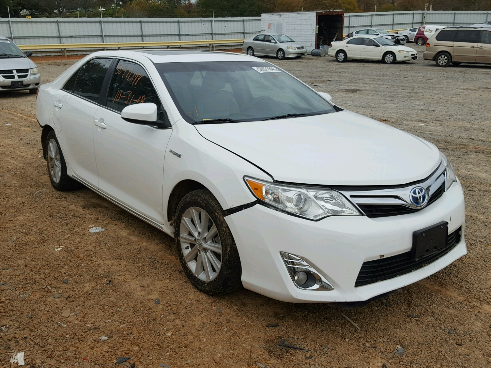 Salvage 2014 Toyota CAMRY HYBRID for sale