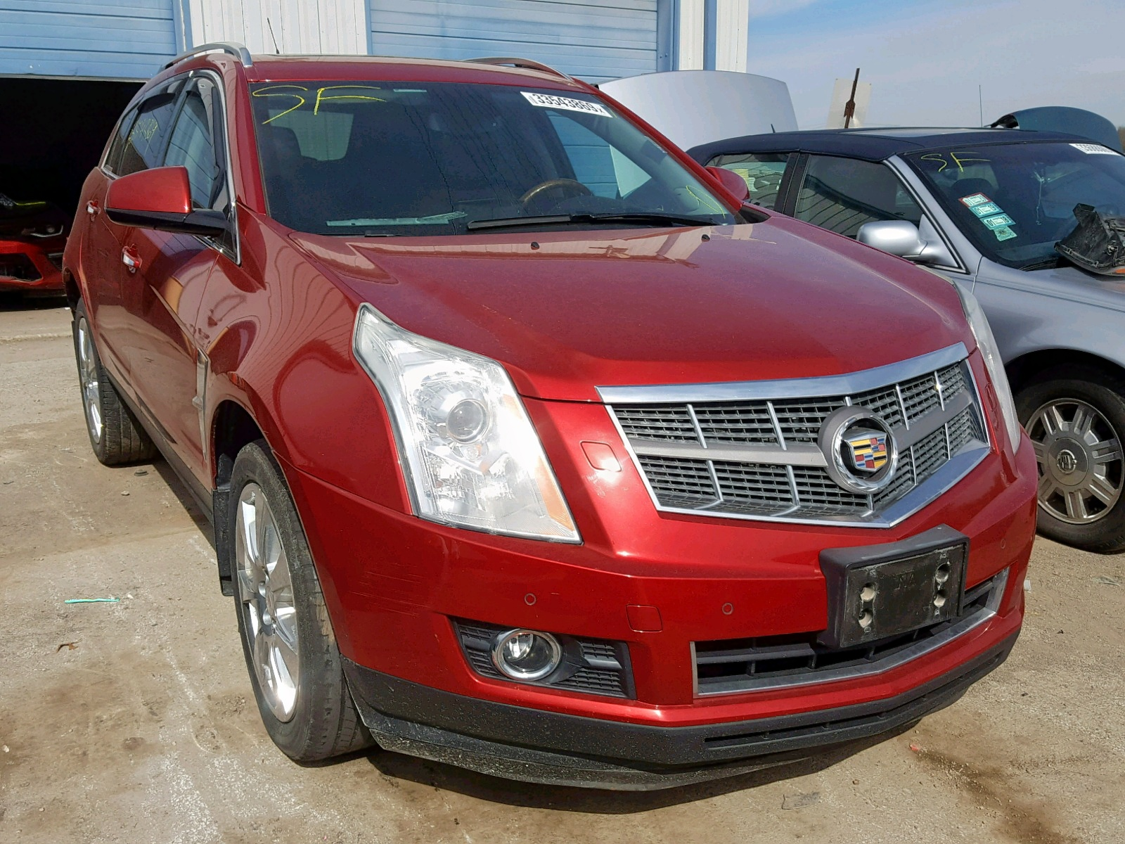 Salvage 2011 Cadillac SRX PERFOR for sale