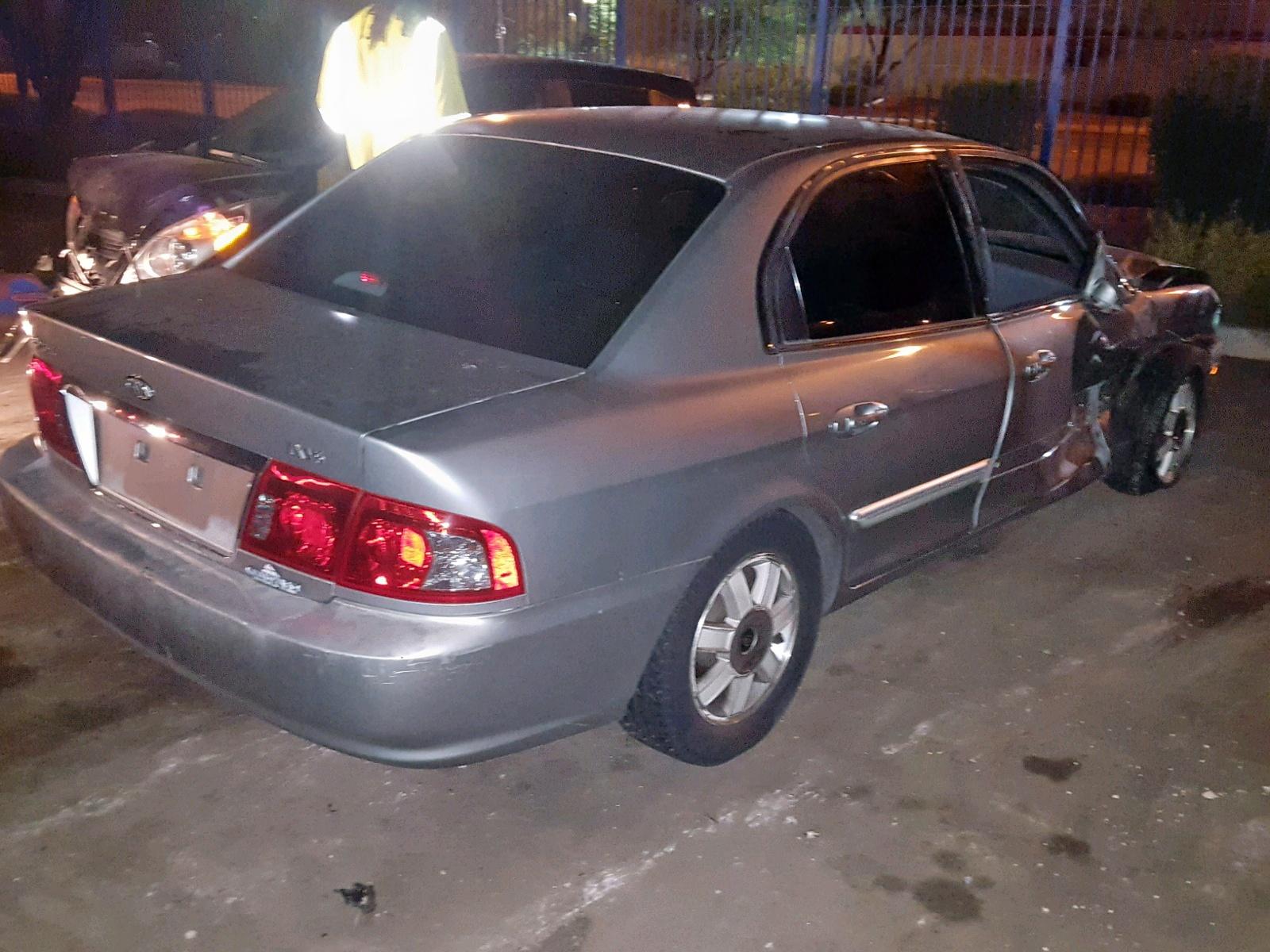 KNAGD128635193948 - 2003 Kia Optima Lx 2.7L rear view