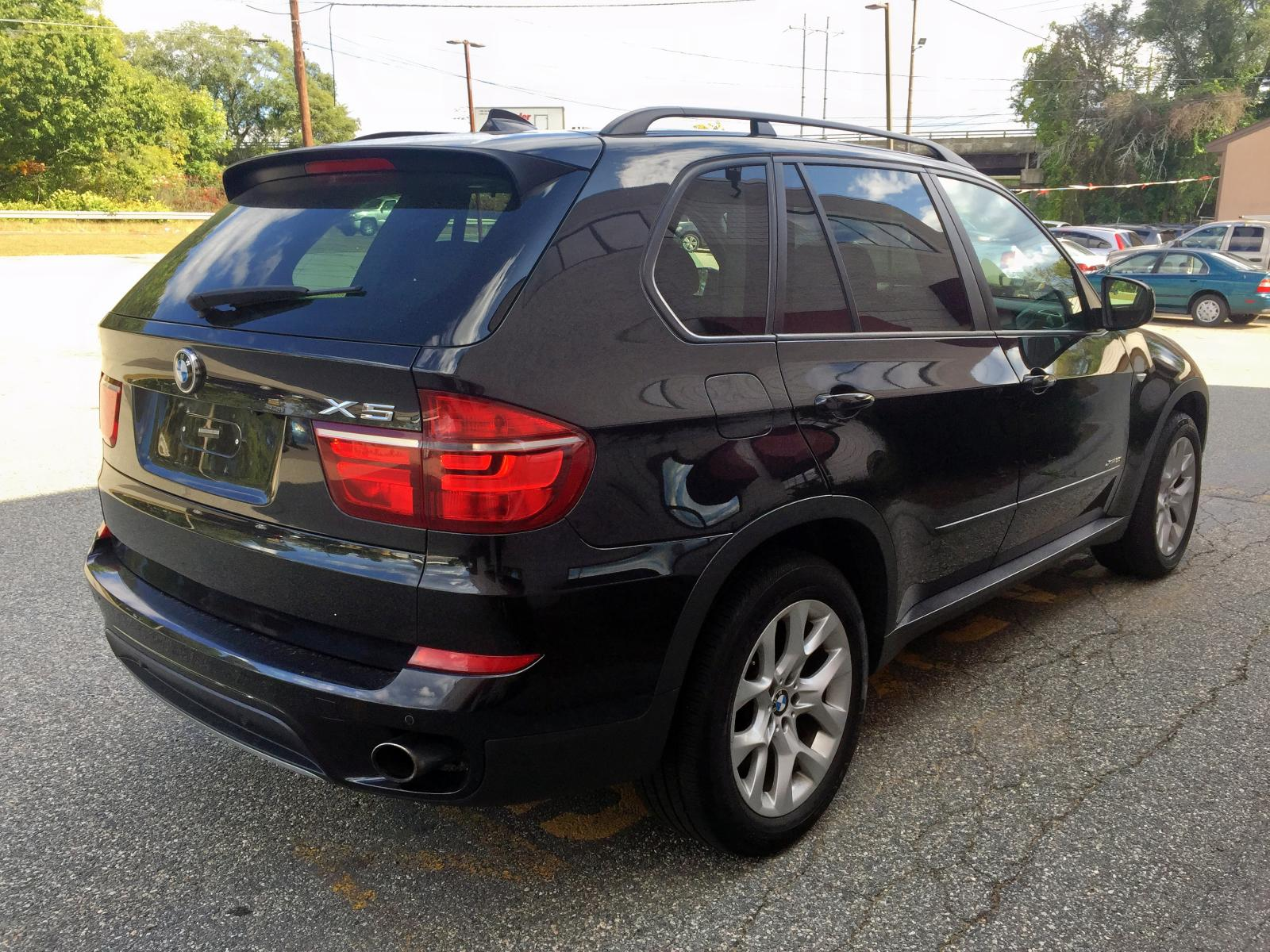 5UXZV4C51BL403394 - 2011 Bmw X5 Xdrive3 3.0L rear view