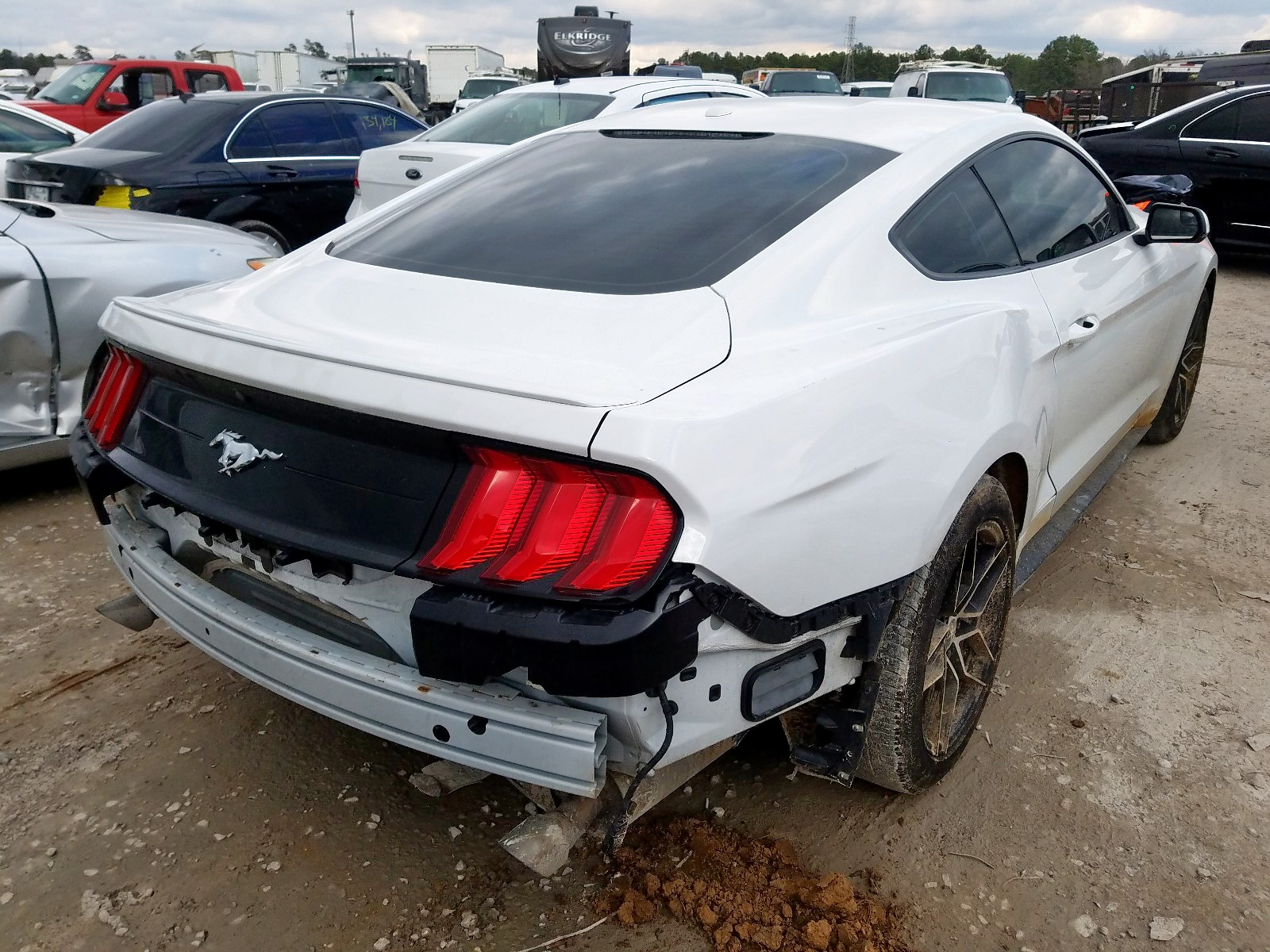 1FA6P8TH4J5115720 - 2018 Ford Mustang 2.3L rear view