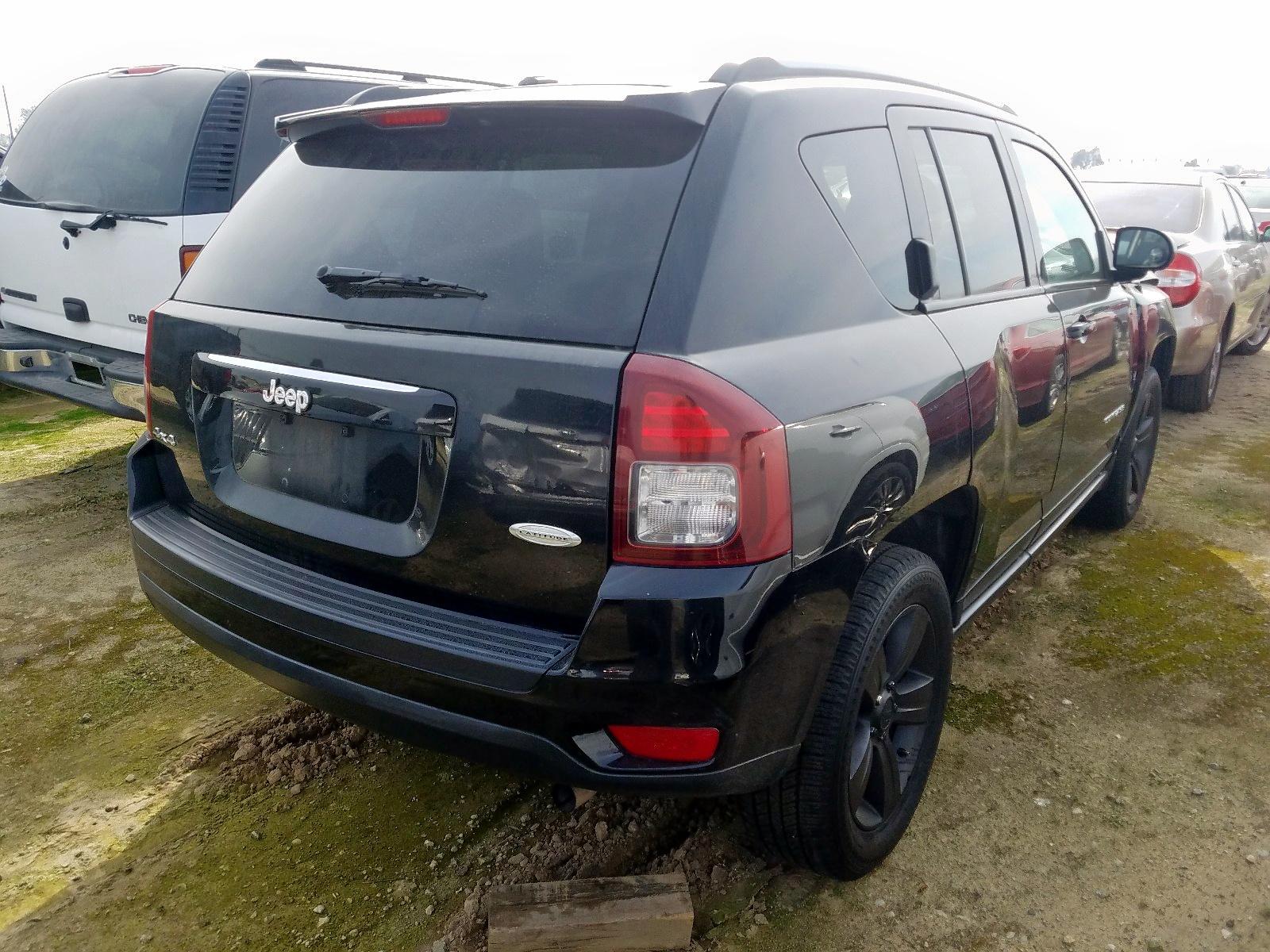1C4NJDEB5GD733149 - 2016 Jeep Compass La 2.4L rear view
