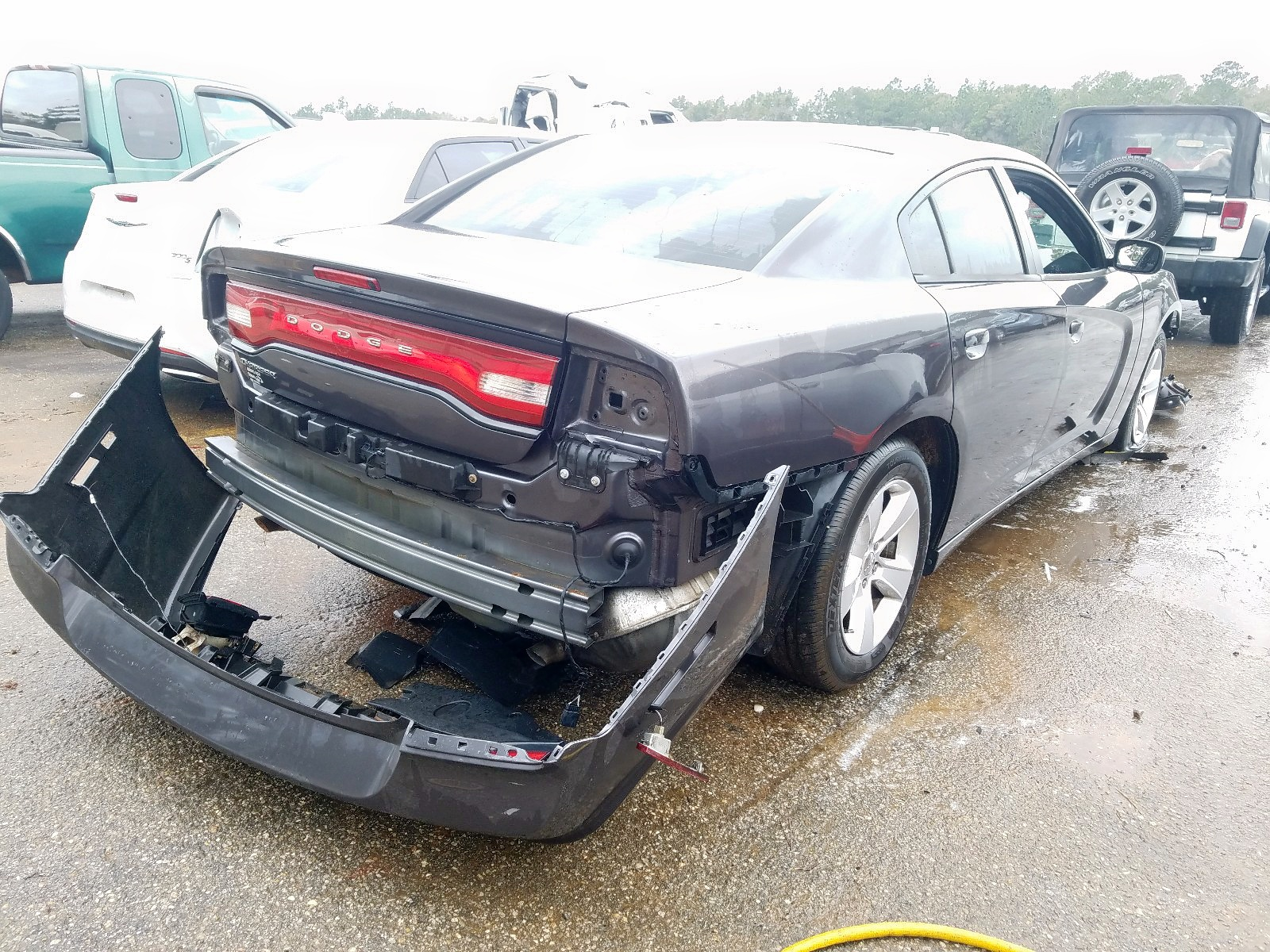 2C3CDXBG7EH130837 - 2014 Dodge Charger Se 3.6L rear view