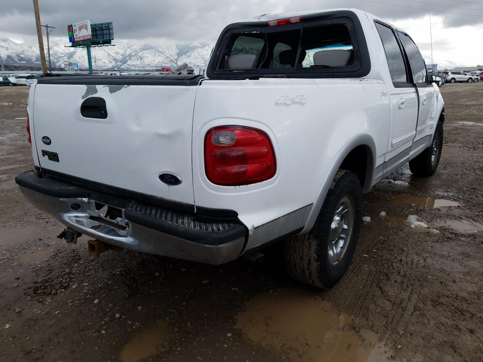 1FTRW08L01KB33707 - 2001 Ford F150 Super 5.4L rear view
