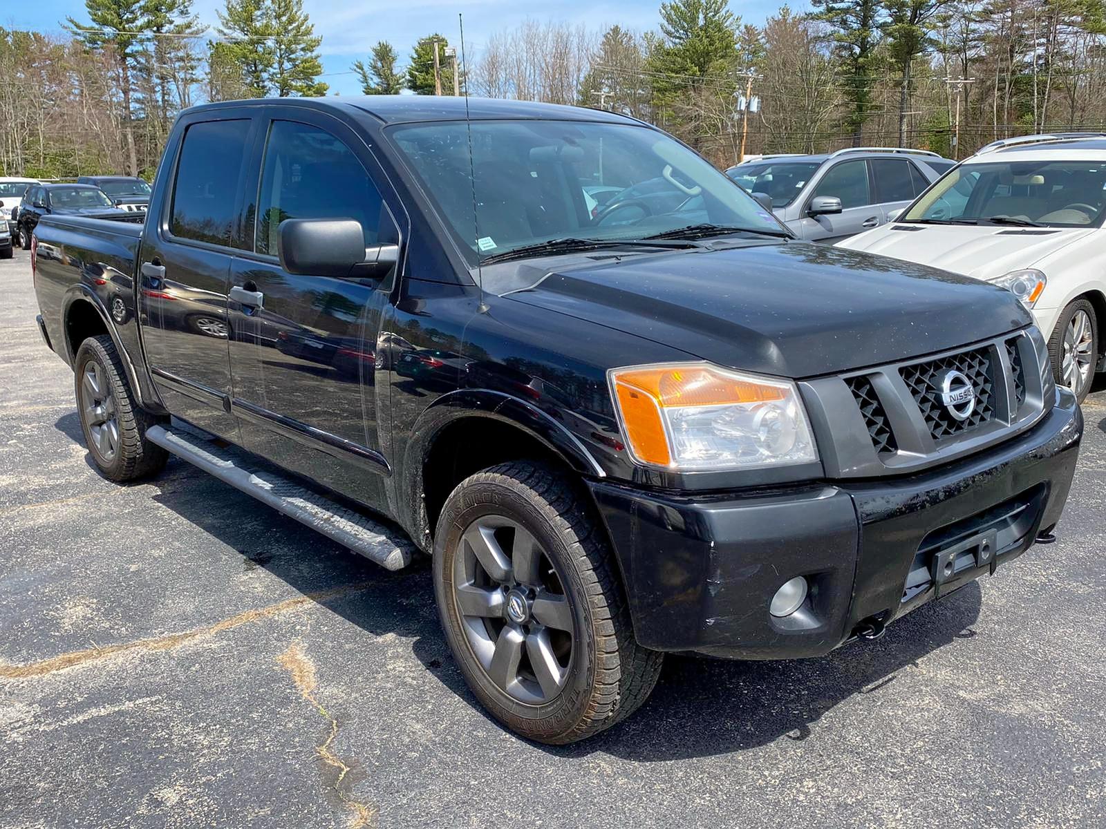 1N6AA0EJ9CN311613 - 2012 Nissan Titan S 5.6L Left View
