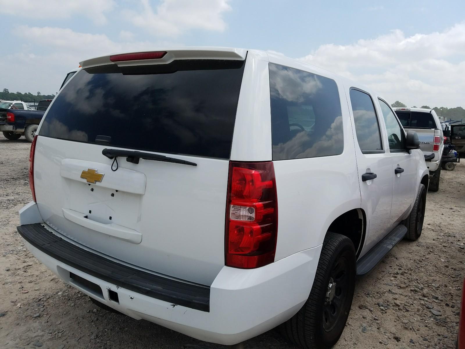 1GNLC2E09DR314859 - 2013 Chevrolet Tahoe Poli 5.3L rear view