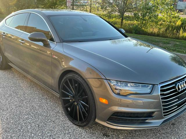 Salvage cars for sale from Copart Blaine, MN: 2016 Audi A7 Premium