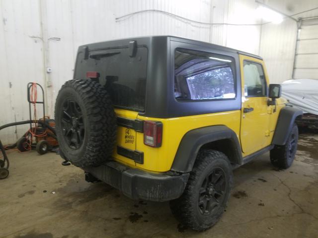 1C4AJWAG7FL576031 - 2015 Jeep Wrangler S 3.6L rear view
