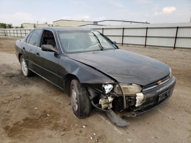 Salvage cars for sale from Copart Bakersfield, CA: 1994 Toyota Camry XLE