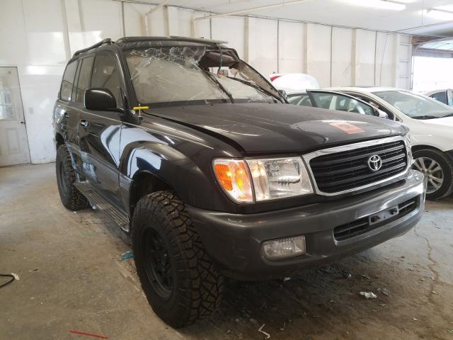 Salvage cars for sale from Copart Madisonville, TN: 2002 Toyota Land Cruiser