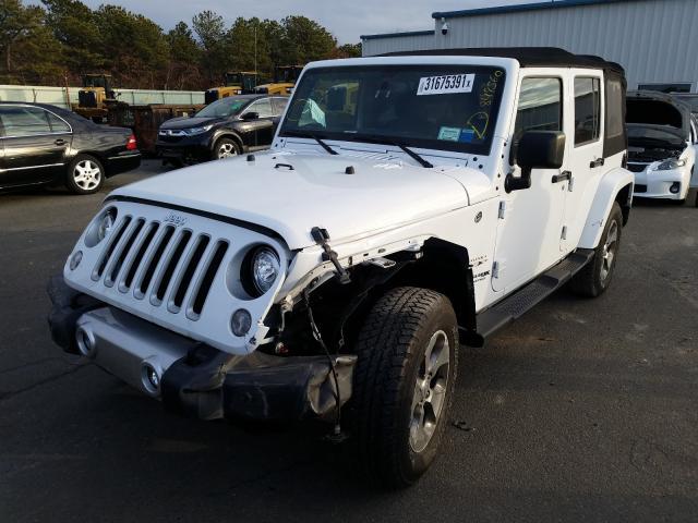 из сша 2018 Jeep Wrangler U 3.6L 1C4BJWEG9JL849560