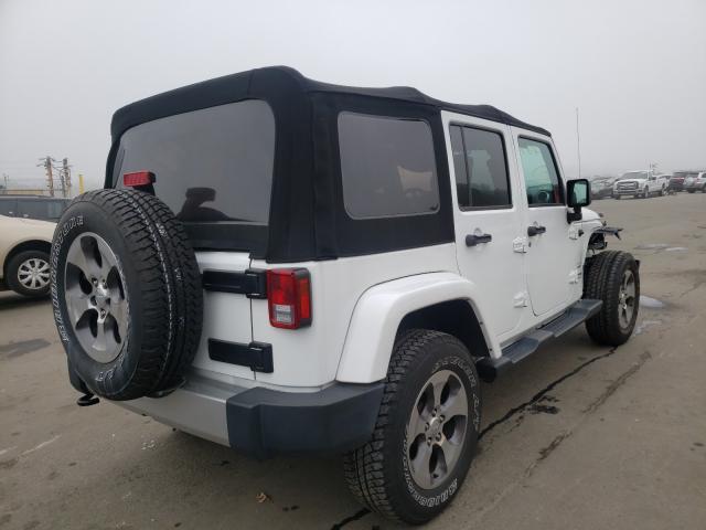 цена в сша 2018 Jeep Wrangler U 3.6L 1C4BJWEG9JL849560