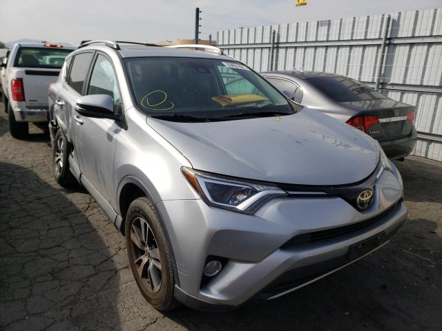 Salvage cars for sale from Copart Colton, CA: 2017 Toyota Rav4 XLE