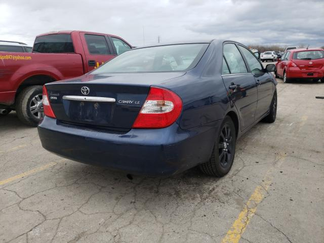 2004 TOYOTA CAMRY LE - Right Rear View