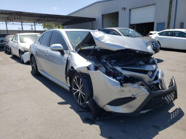 Salvage cars for sale from Copart Orlando, FL: 2019 Toyota Camry Hybrid