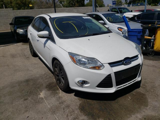 Salvage cars for sale from Copart Colton, CA: 2012 Ford Focus SEL