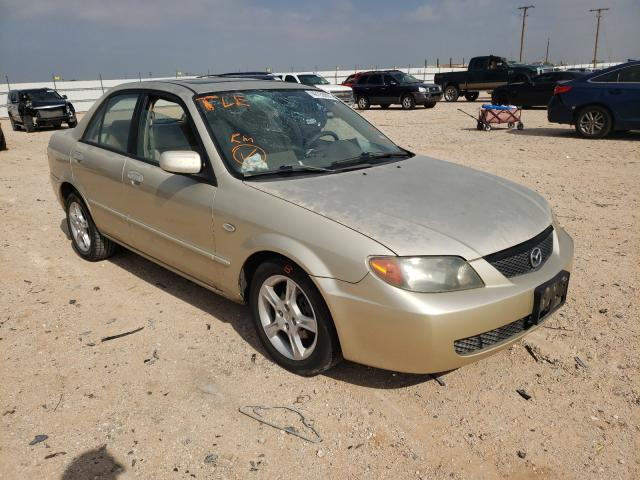Salvage cars for sale from Copart Andrews, TX: 2003 Mazda Protege DX