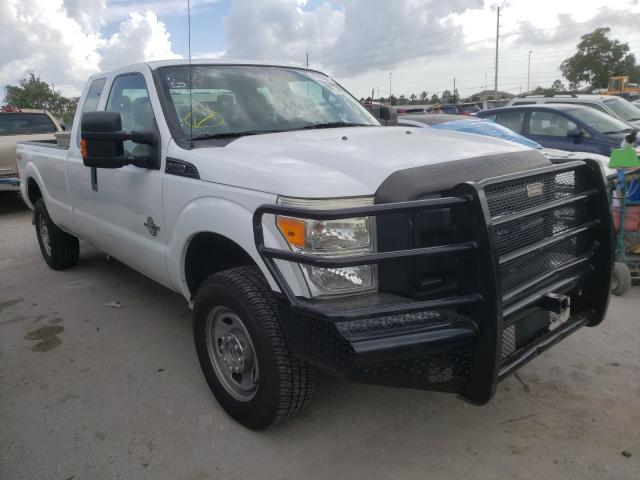 Salvage cars for sale from Copart Riverview, FL: 2011 Ford F250 Super
