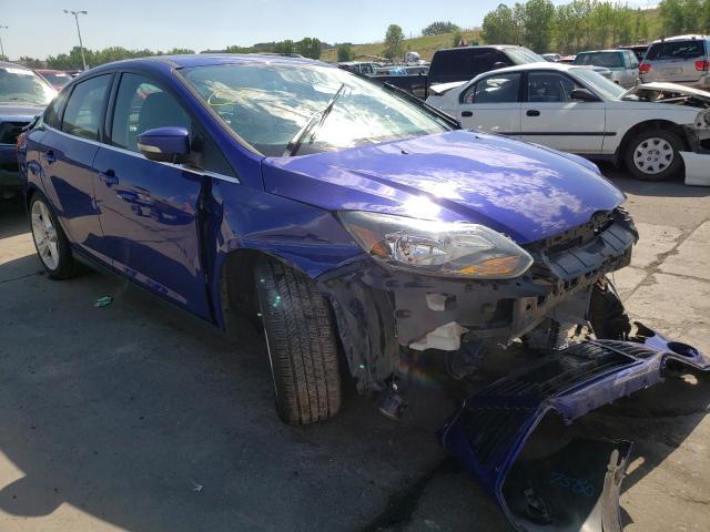 Salvage cars for sale at Littleton, CO auction: 2014 Ford Focus Titanium