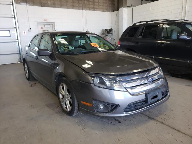 Salvage cars for sale from Copart Blaine, MN: 2012 Ford Fusion SE