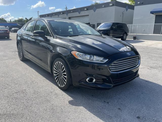 Flood-damaged cars for sale at auction: 2017 Ford Fusion SE
