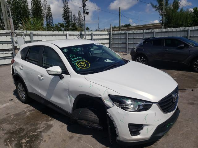 Salvage cars for sale from Copart Miami, FL: 2016 Mazda CX-5 Sport