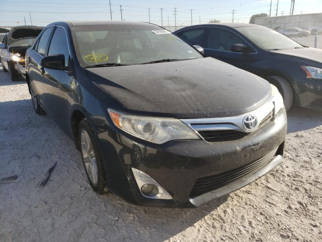 Salvage cars for sale from Copart Haslet, TX: 2014 Toyota Camry Hybrid